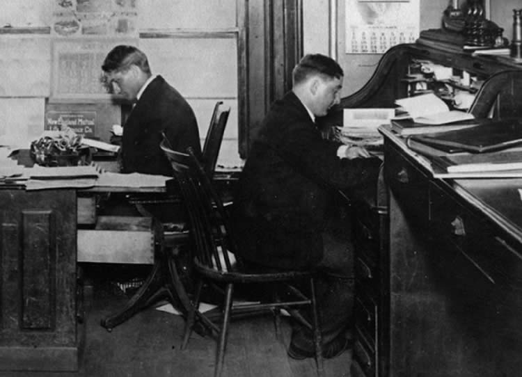 Adam E. Cornelius (l) and John J. Boland (r) in the company's first Buffalo, NY office.